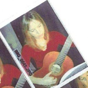 Monica Playing Guitar